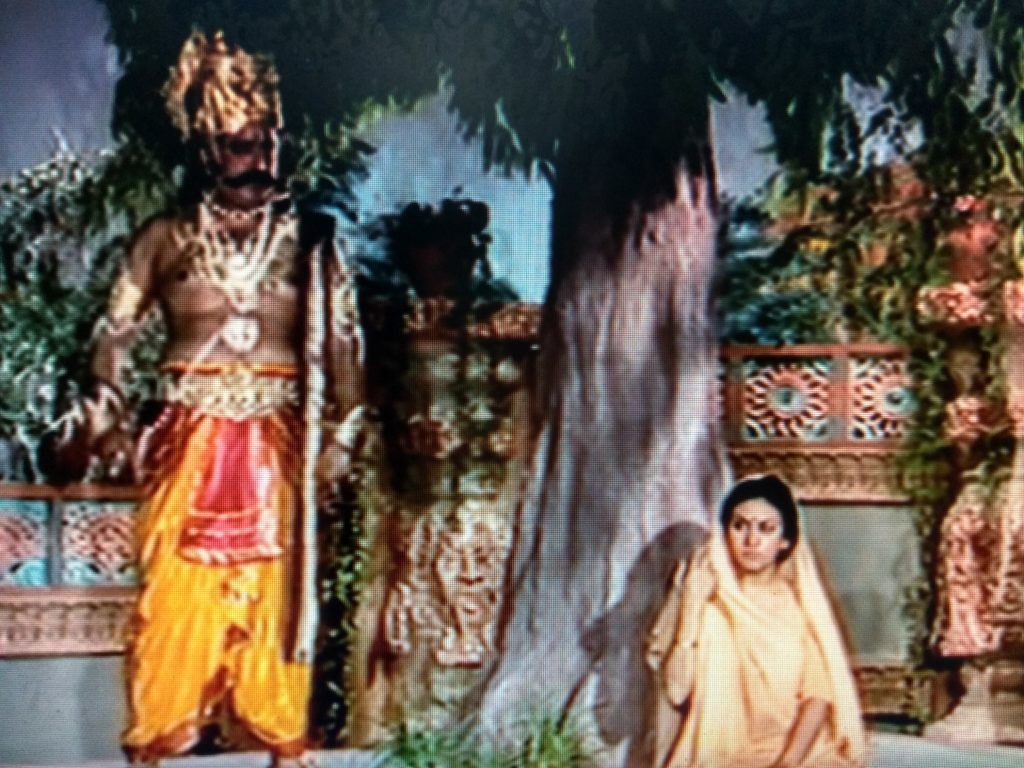 Ravana tries to convince goddess Sita for marriage in Ramayana