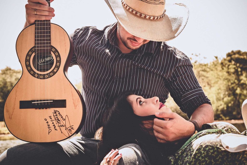 Boy impresses a woman with his guitar talent-photo by pexels..loveyoufamily.com