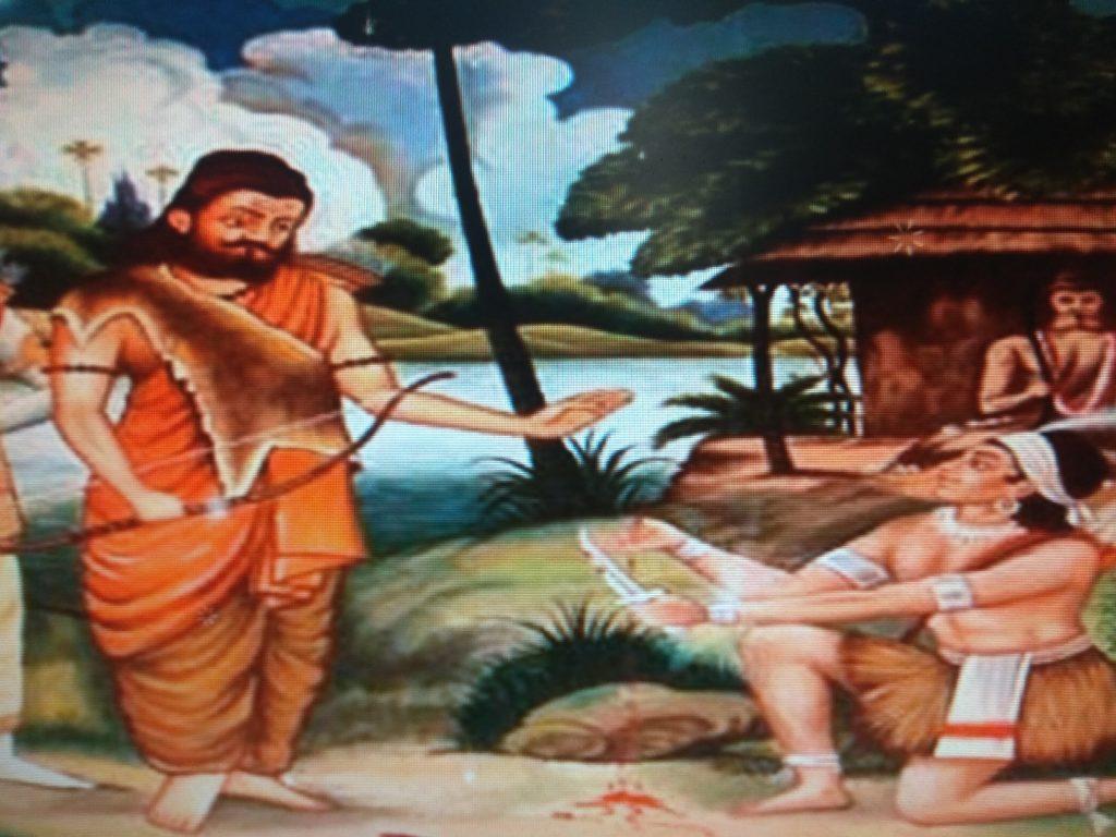 Eklavya cutting his thumb for guru Dronacharya